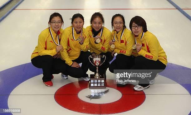 The winning China team of Bingyu Wang Yin Liu Qingshuang Yue Yan Zhou and Jinli Liu pose for a photo at the Pacific Asia 2012 Curling Championship at...