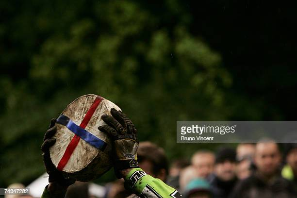 The winning competitor holds up his cheese trophy at Coopers Hill after chasing the cheese during the Cheese rolling event on May 28 2007 in...