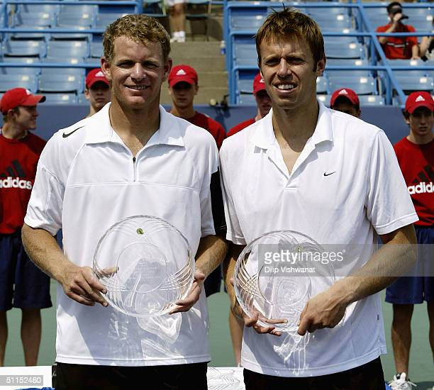 The winning doubles team of Mark Knowles and Daniel Nestor accept their first place trophies during the Western and Southern Financial Group Masters...