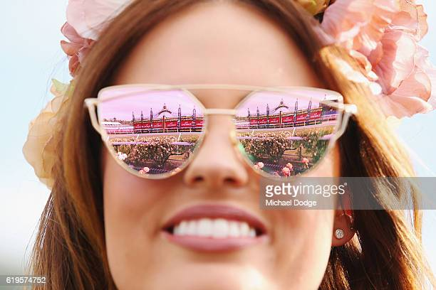 The winning post is seen reflected from a racegoers glasses on Melbourne Cup Day at Flemington Racecourse on November 1 2016 in Melbourne Australia