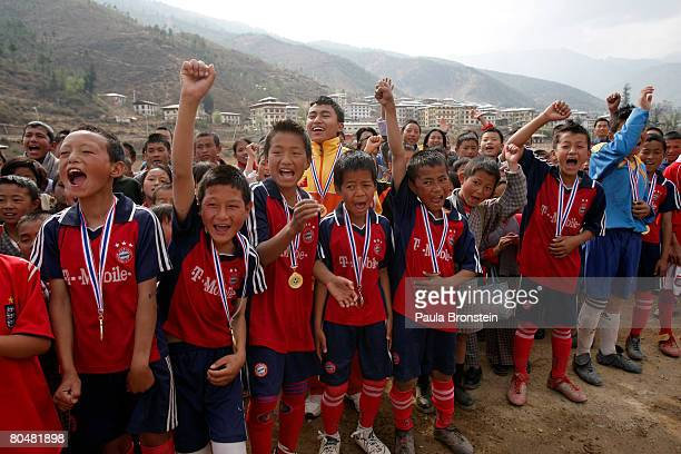The winning soccer team from the Loselling Lower Secondary school cheer after the finals of a local tournament March 31 2008 in Thimphu Bhutan March...