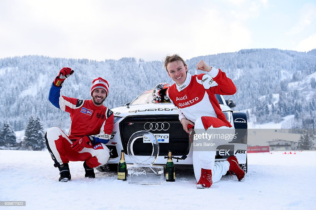 The winning team Andrea Dovizioso and Henrik Kristoffersen pose with the trophy after the final day of the Audi Quattro #SuperQ on January 20, 2016 in Kitzbuehel, Austria.