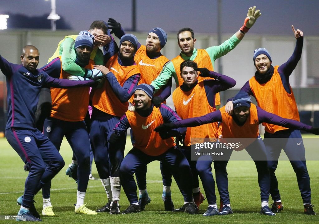 The winning team of Fernandinho, Ederson Moraes, Yaya Toure, Vincent Kompany, Nicolas Otamendi, Sergio Aguero, Claudio Bravo, Brahim Diaz, Raheem Sterling and David Silva celebrate during training at Manchester City Football Academy on November 28, 2017 in Manchester, England.