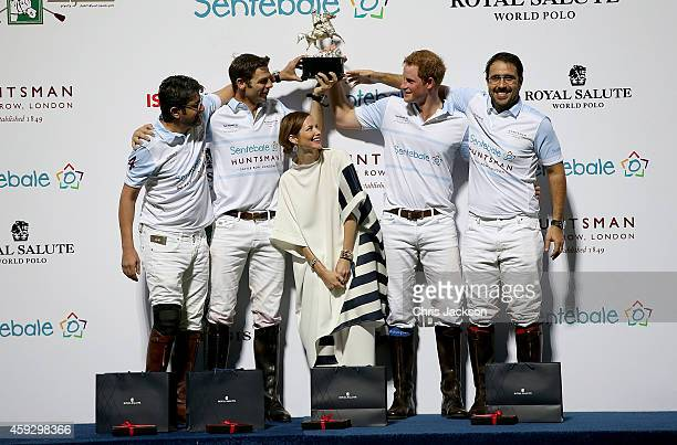 The winning team the Sentebale Huntsman Team Abdulla Ben Desmal Malcolm Borwick Prince Harry and Saeed Bin Drai with Sienna Guillory during the...