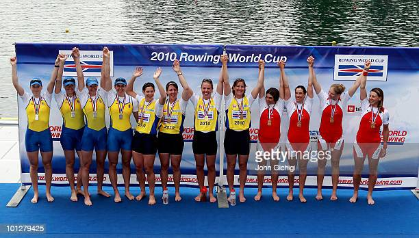 The winning teams of Ukraine Great Britain and Switzerland celebrate after the Women's Quadruple Sculls during the 2010 Rowing World Cup on Lake Bled...