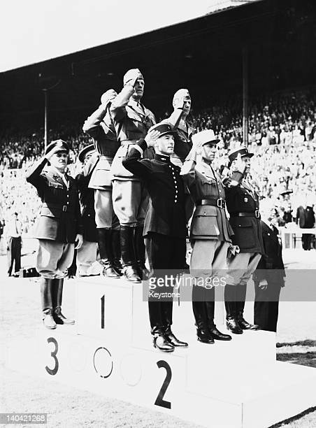 The winning threedayevent teams on the podium at the Olympic Games Wembley Stadium London 14th August 1948