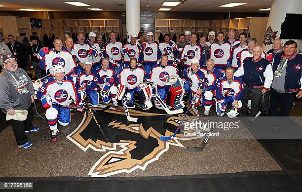 The Winnipeg Jets alumni team pose in the locker room before playing in the 2016 Tim Hortons NHL Heritage Classic Alumni Game against the Edmonton...