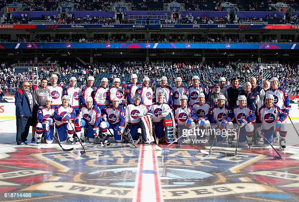 The Winnipeg Jets alumni team poses on centre ice before the 2016 Tim Hortons NHL Heritage Classic Alumni Game to be played against the Winnipeg Jets...