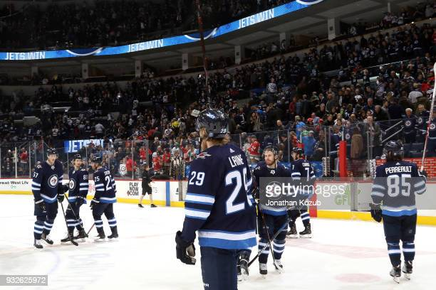 The Winnipeg Jets celebrate a 62 victory over the Chicago Blackhawks in front of home fans at the Bell MTS Place on March 15 2018 in Winnipeg...