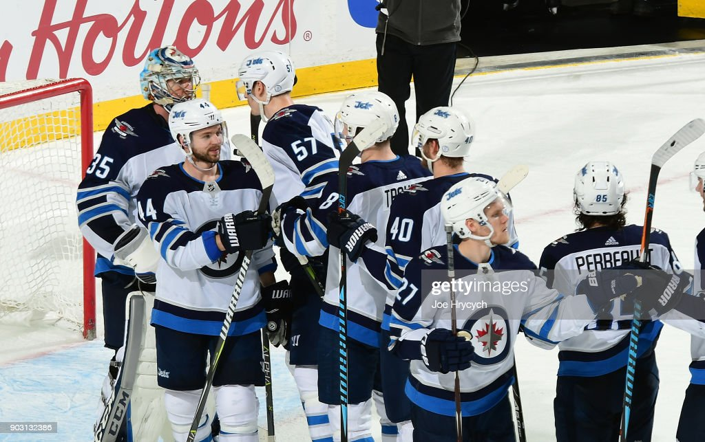 The Winnipeg Jets congratulate goaltender Steve Mason #35 following their 7-4 victory over the Buffalo Sabres in an NHL game on January 9, 2018 at KeyBank Center in Buffalo, New York.