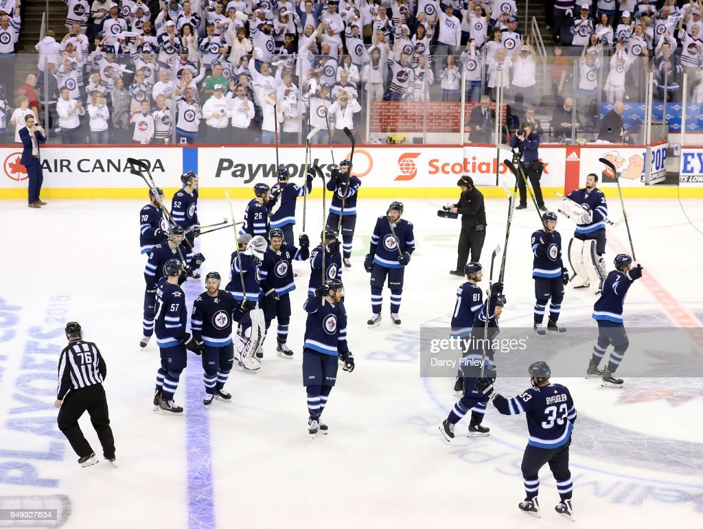 The Winnipeg Jets salute the fans following a 5-0 shutout victory over the Minnesota Wild in Game Five of the Western Conference First Round during the 2018 NHL Stanley Cup Playoffs at the Bell MTS Place on April 20, 2018 in Winnipeg, Manitoba, Canada.