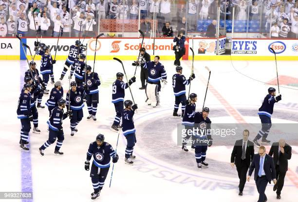 The Winnipeg Jets salute the fans following a 50 shutout victory over the Minnesota Wild in Game Five of the Western Conference First Round during...