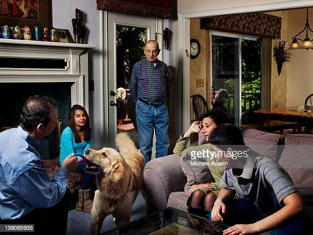 The Winokur family with their service dog Chancer are photographed for New York Times Magazine on January 12 2012 in Roswell Georgia Iyal adopted son...