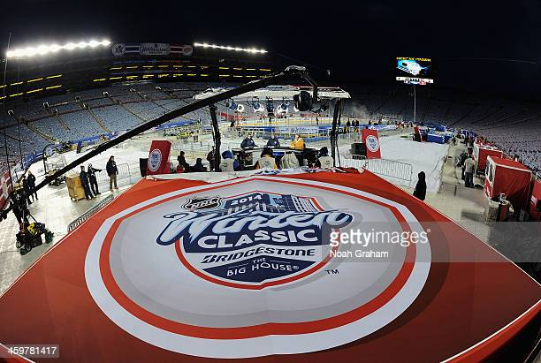 The Winter Classic logo is seen as hosts EJ Hradek and Darren Pang talk with hockey analyst Barry Melrose on NHL Live during the 2014 Bridgestone NHL...