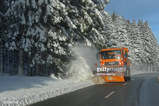 The winter road maintenance vehicle cleans the road between Wernigerode and Schierke near DreiAnnenHohne Germany 14 January 2017 The snow is now more...