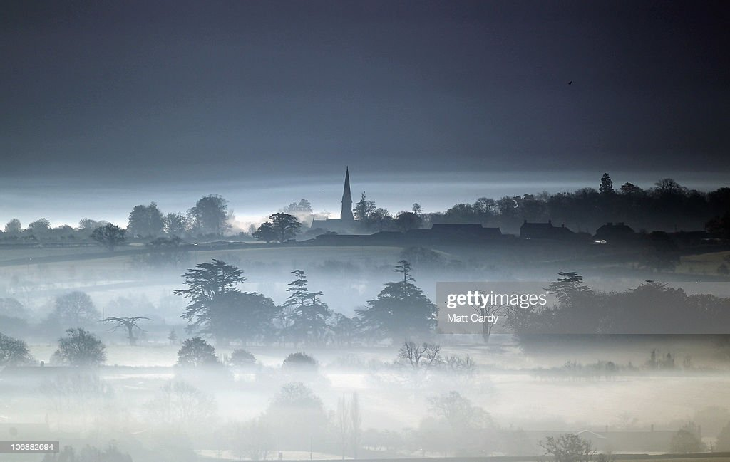 The winter sun begins to rise over mist and fog that has formed over fields on the Somerset Levels on November 15, 2010 in Glastonbury, England. After being battered by strong winds and heavy rain last week, parts of the UK are enjoying cold, fine winter weather. However more wind and rain is forecast to hit later in this week.