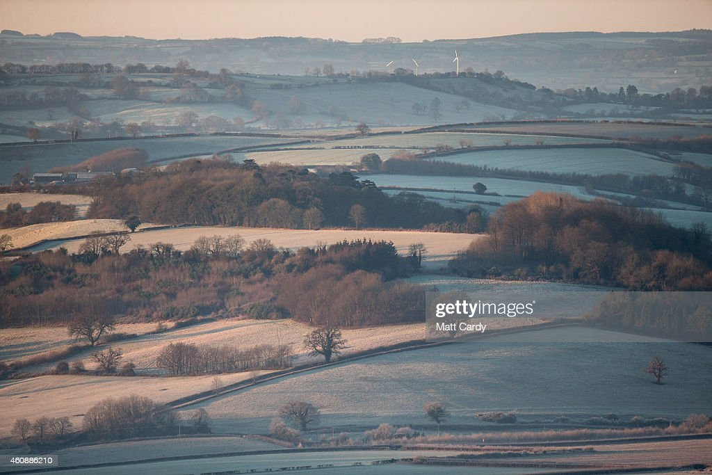 The winter sun rises over fields near Bath on December 29, 2014 in Bath and North East Somerset, England. According to the Met Office Britain experienced the coldest night of the year overnight, with some areas being even colder than Alaska and the Antarctica and as forecasters believe it could get even colder tonight, a Met Office cold weather alert for northern England and the Midlands has warned of health risks for vulnerable people.