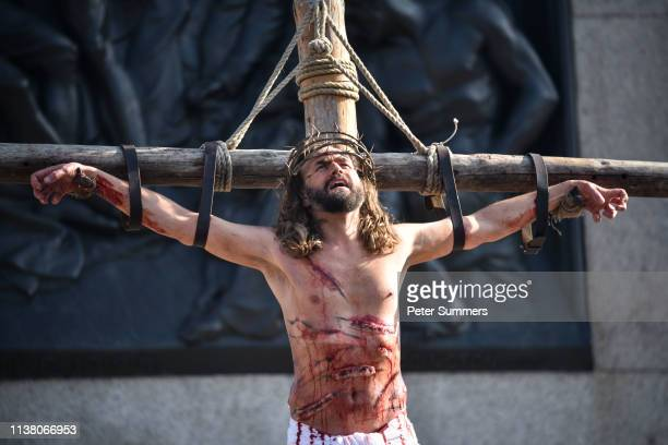 The Wintershall Players perform 'The Passion of Jesus' in front of crowds in Trafalgar Square on Good Friday April 19 2019 in London England Good...