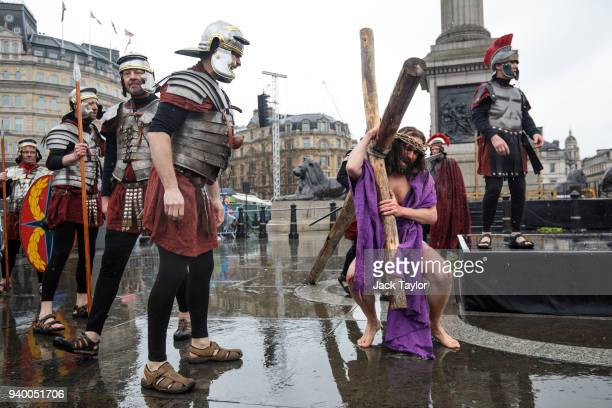 The Wintershall Players perform 'The Passion of Jesus' in front of crowds in Trafalgar Square on March 30 2018 in London England Good Friday is a...