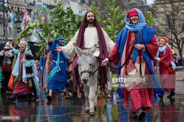 The Wintershall Players perform 'The Passion of Jesus' in front of crowds in Trafalgar Square on March 30, 2018 in London, England. Good Friday is a...