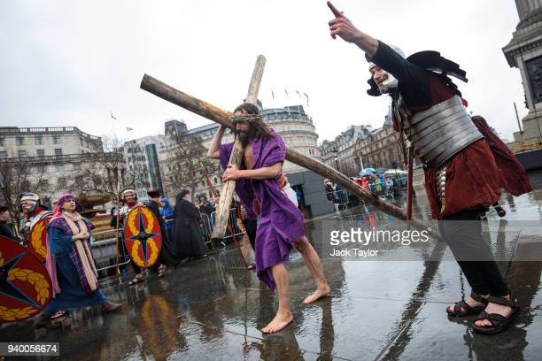 The Wintershall Players perform 'The Passion of Jesus' in front of crowds in Trafalgar Square on Good Friday March 30 2018 in London England Good...