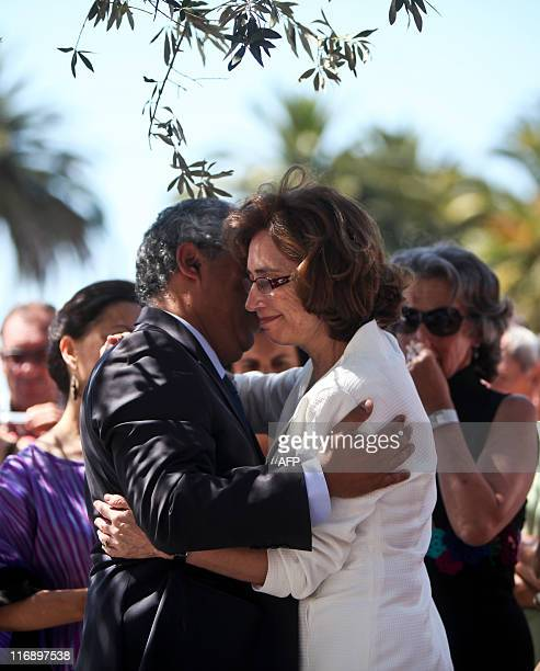 The wirdow of Portuguese novelist Jose Saramago Pilar del Rio and Lisbon Mayor Antonio Costa confort each other after a ceremony on June 18 2011...