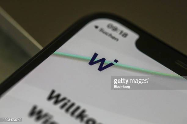 The Wirecard AG logo sits on the company's payment app log in screen on an Apple Inc. IPhone X smartphone in this arranged photograph in Frankfurt,...