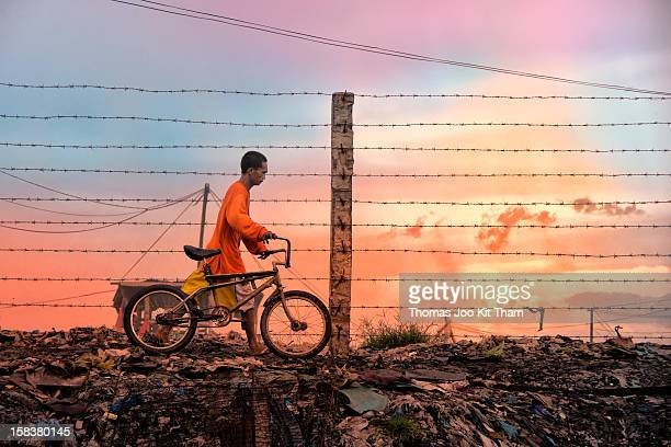 The wired fence separated the dumpsite and the Charcoal community. You are not allowed to go beyond this fence as it is out of bound. Manila, Tondo,...