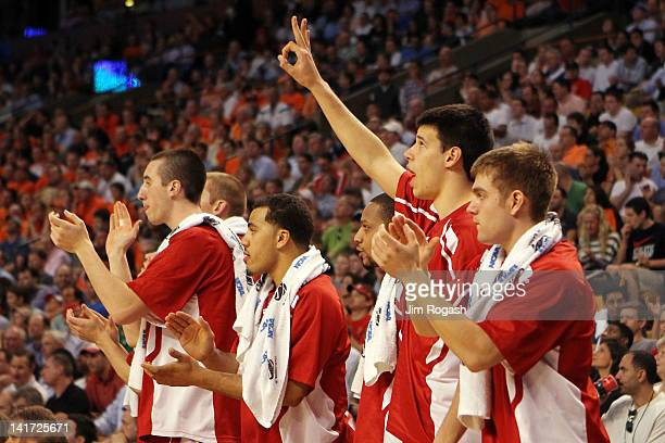The Wisconsin Badgers bench reacts after a basket against the Syracuse Orange during their 2012 NCAA Men's Basketball East Regional Semifinal game at...