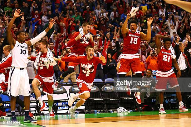 The Wisconsin Badgers bench reacts after Bronson Koenig makes the game winning basket at the buzzer against the Xavier Musketeers during the second...