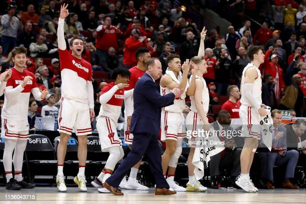 The Wisconsin Badgers bench reacts in the second half against the Nebraska Huskers during the quarterfinals of the Big Ten Basketball Tournament at...