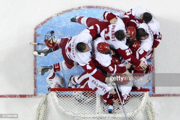 The Wisconsin Badgers bench topples goaltender Brian Elliott after they won the NCAA Men's Frozen Four Championship game on April 8, 2006 at the...