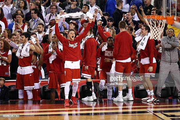 The Wisconsin Badgers celebrate after defeating the Kentucky Wildcats during the NCAA Men's Final Four Semifinal at Lucas Oil Stadium on April 4,...