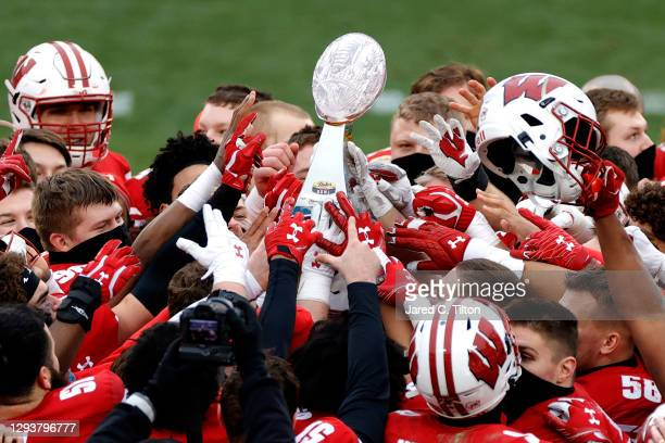The Wisconsin Badgers celebrate their victory over the Wake Forest Demon Deacons after winning the Duke's Mayo Bowl at Bank of America Stadium on...