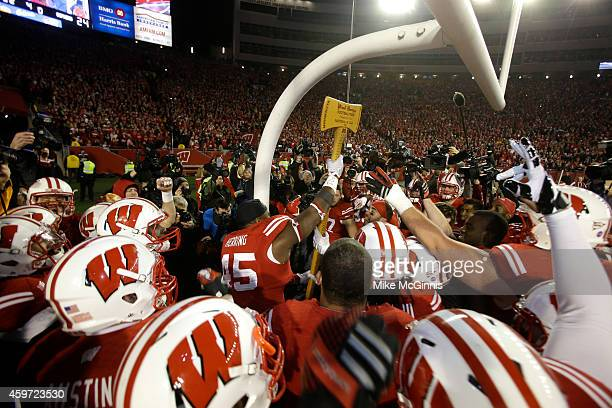 The Wisconsin Badgers celebrate with the Paul Bunyan axe after the 3424 win over the Minnesota Golden Gophers at Camp Randall Stadium on November 29...