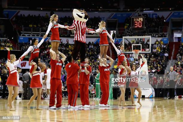 The Wisconsin Badgers cheerleaders perform during the Big Ten Basketball Tournament Championship game between the Badgers and Michigan Wolverines at...
