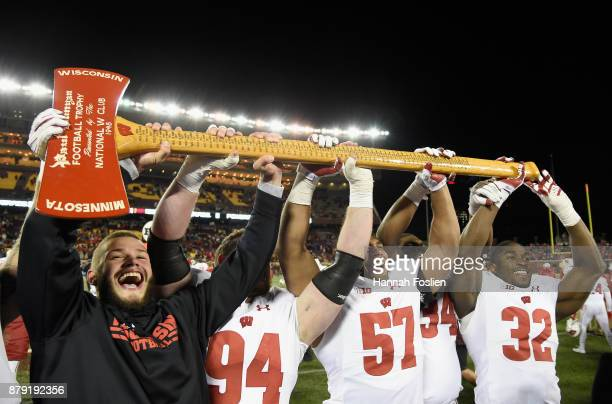 The Wisconsin Badgers hoist Paul Bunyan's Axe after winning the game against the Minnesota Golden Gophers on November 25 2017 at TCF Bank Stadium in...