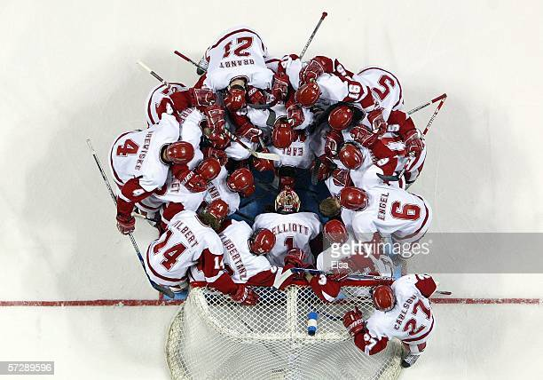 The Wisconsin Badgers huddle before the NCAA Men's Frozen Four Championship game on April 8,2006 at the Bradley Center in Milwaukee, Wisconsin. The...