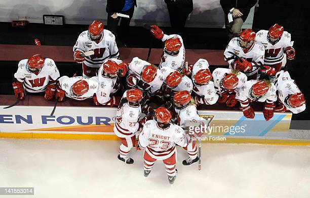 The Wisconsin Badgers huddle up on the bench during an injury timeout during the third period of the championship game of the 2012 NCAA Women's...