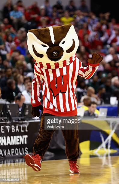 The Wisconsin Badgers mascot, Bucky Badger, performs during the second half of the Big Ten Basketball Tournament Semifinal game against the Michigan...