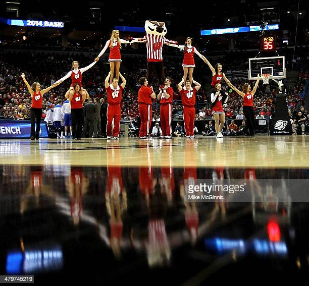 The Wisconsin Badgers mascot Bucky Badger performs with cheerleaders during the second round game of NCAA Basketball Tournament against the American...