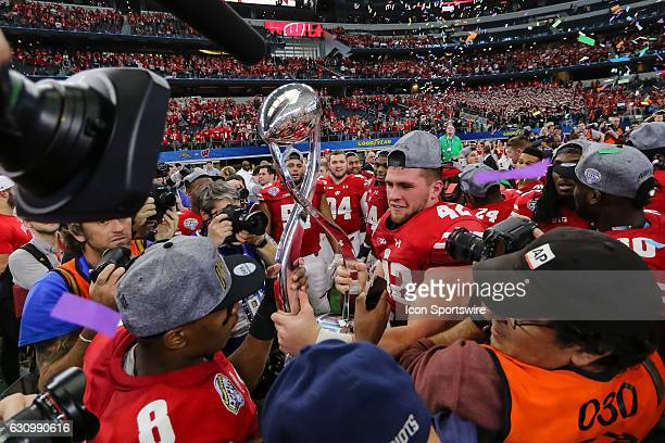 The Wisconsin Badgers players celebrate winning the 81st Goodyear Cotton Bowl Classic game between the Western Michigan Broncos and the Wisconsin...