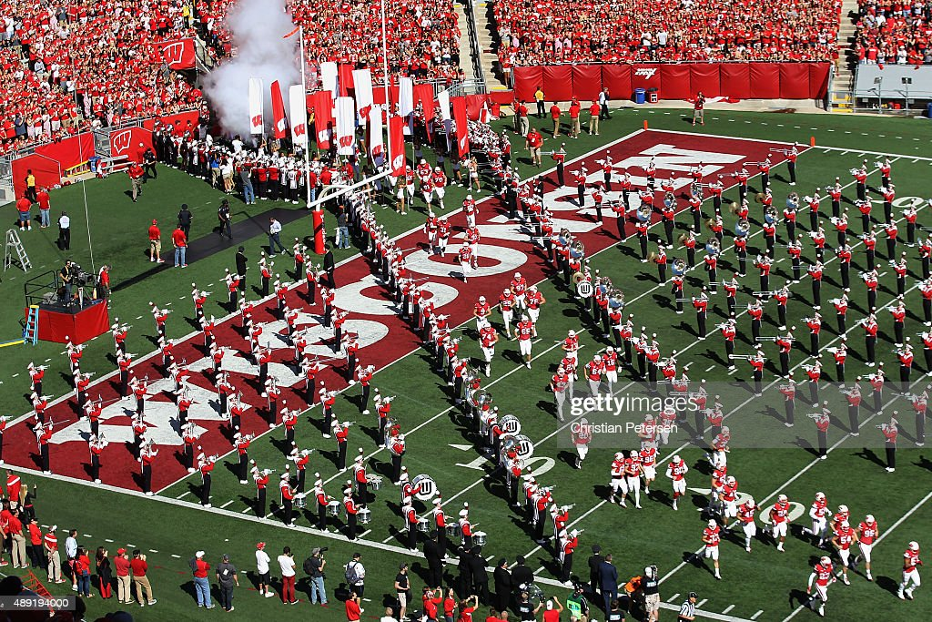 The Wisconsin Badgers Run Onto The Field As They Are