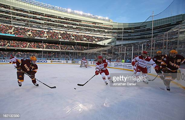 The Wisconsin Badgers take on the Minnesota Golden Gophers during the Hockey City Classic at Soldier Field on February 17 2013 in Chicago Illinois