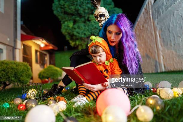 the witch tells the story to the pumpkin for halloween. - animator stock pictures, royalty-free photos & images