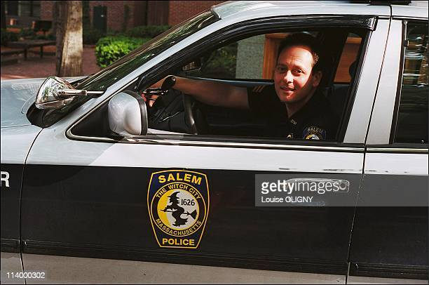 The witches of Salem In Salem United States In 2001A Salem police officer wears the town emblem sporting the logo The Witch City