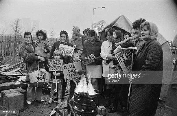 The wives and children of British miners on a picket line outside one of the two power stations at Rugeley in Staffordshire during a national strike...