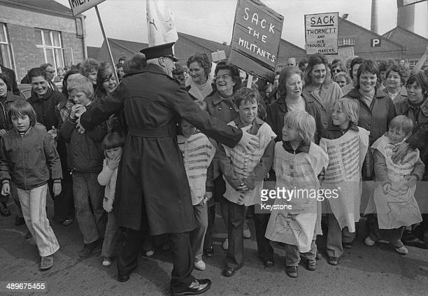 The wives and children of laidoff workers protest against a strike by 150 internal transport drivers at the British Leyland car plant in Cowley...