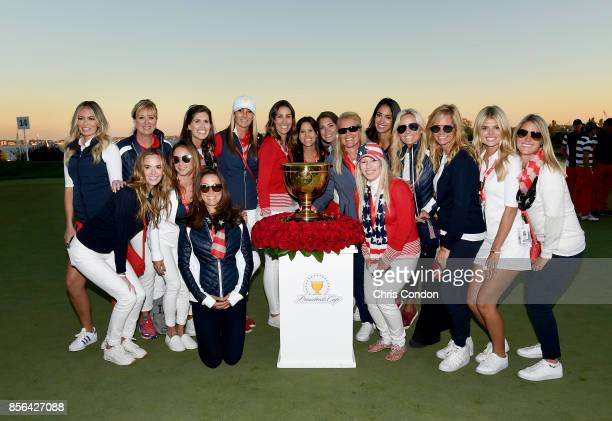 The wives and girlfriends of the US Team pose with the trophy after the US Team defeated the International Team 19 to 11 in the Presidents Cup at...