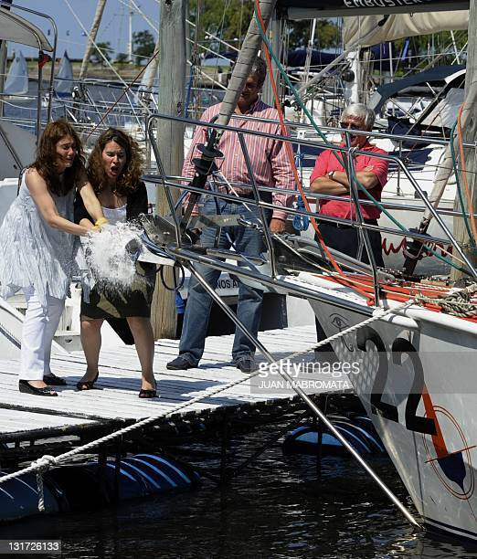 The wives of Argentine skippers Luis Campi and Osvaldo Mauro smash a bottle of champagne during the naming of the sailboat 'Antarktikos' in Buenos...